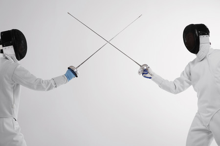 duelling: Two men in fencing suits in a duel