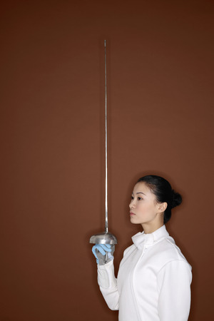 fencing foil: Woman in fencing suit with fencing foil