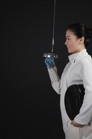fencing foil: Woman with fencing foil Stock Photo