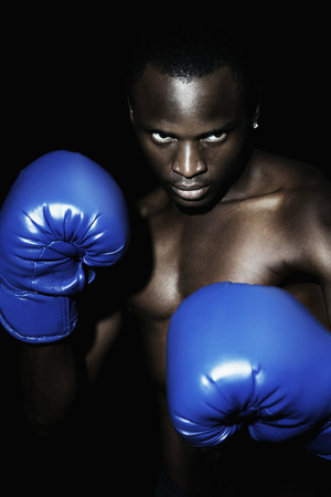 Man with blue boxing gloves photo
