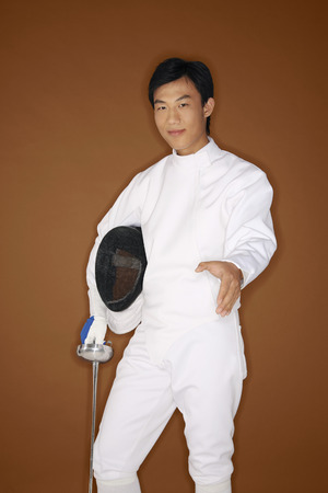 quarter foil: Man in fencing suit extending hand for a handshake Stock Photo