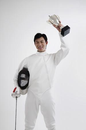quarter foil: Man holding trophy