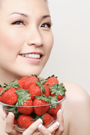Woman holding a bowl of strawberries photo