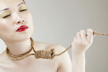noose: Woman holding noose around her neck