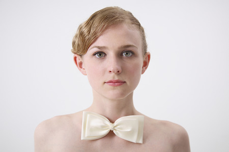 role reversal: Woman with a white bowtie