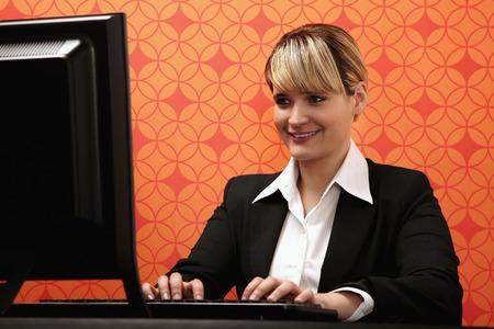 using computer: Businesswoman using computer Stock Photo
