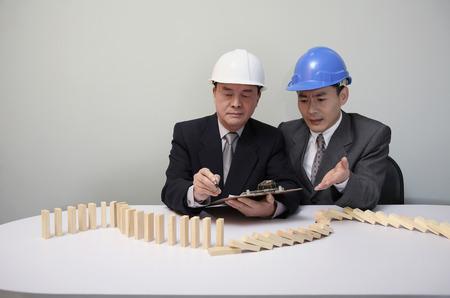 frowns: Businessmen planning