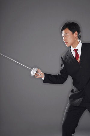 fencing foil: Businessman with a fencing foil