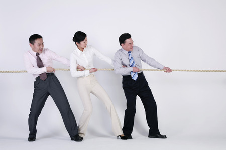 Business people tugging rope photo