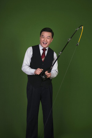 Businessman with a fishing rod photo