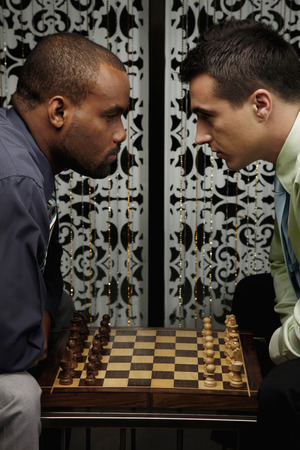 Businessmen playing chess game photo
