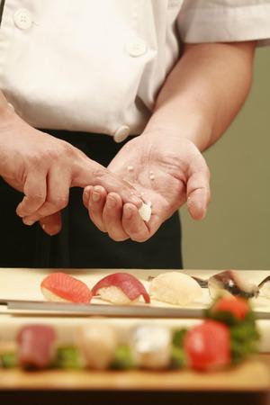 parentage: Chef preparing sushi