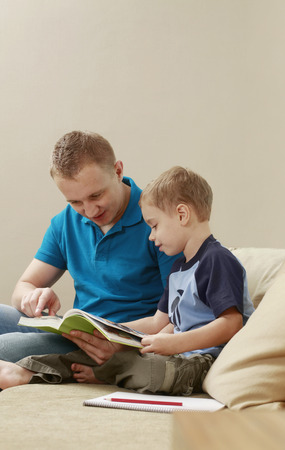reading book: Man and boy reading book
