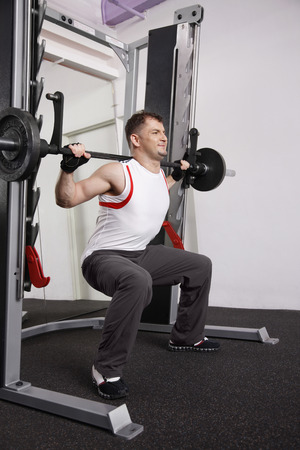 southern european: Man weight lifting in the gym