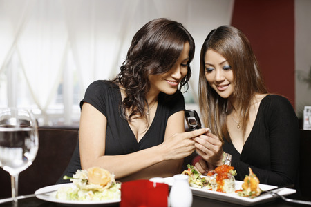 Women looking at a text message photo