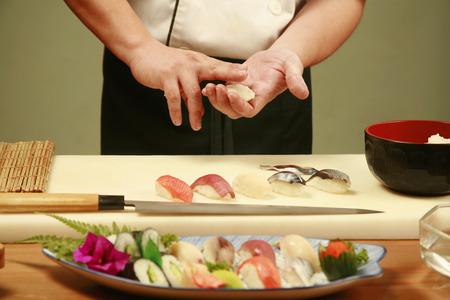 Chef preparing sushi Stock Photo - 26199393