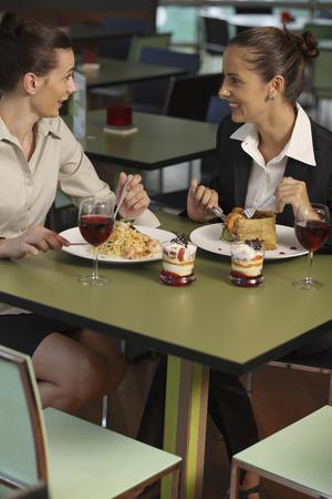 Businesswomen talking over lunch photo