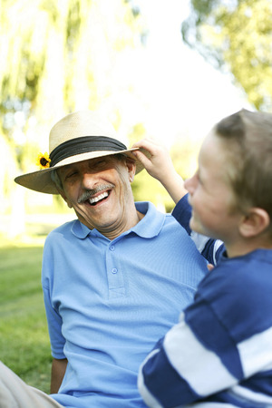 Grandfather and grandson having fun in the park