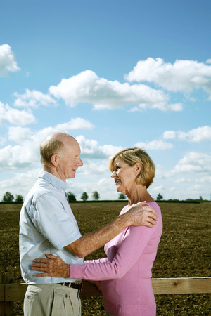 Senior couple looking at each other photo
