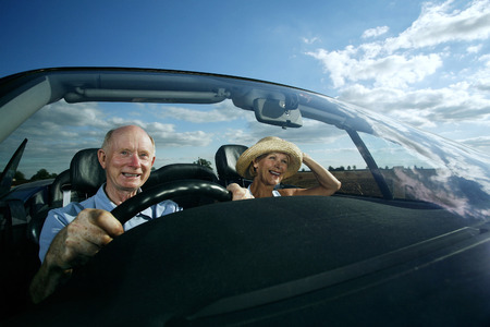 he old: Senior couple travelling together in the car