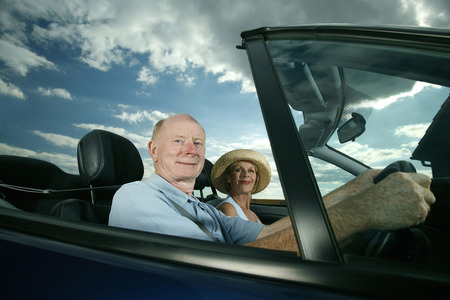 Senior couple travelling together in the car photo