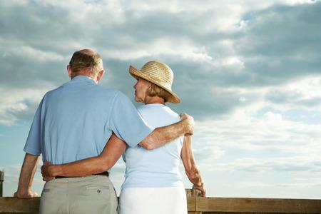 Senior couple enjoying beautiful field scenery photo
