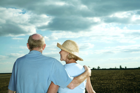 Senior couple enjoying beautiful field scenery photo