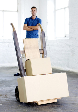 finished good: A man standing behind some goods that are ready to be delivered Stock Photo