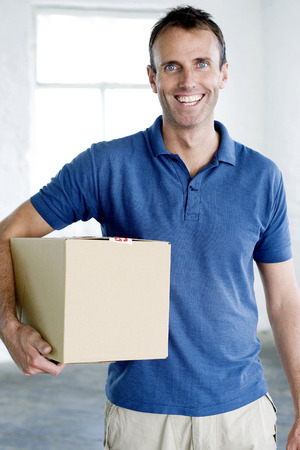 A man carrying a box photo