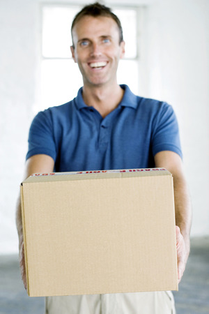 congeniality: A man passing over a parcel happily