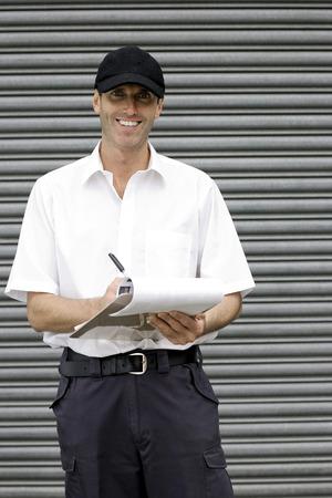 A postal service supervisor compiling data Stock Photo