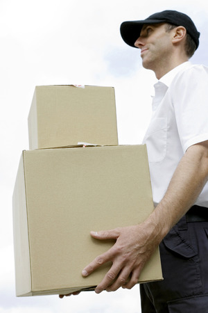 congeniality: Side view of a delivery man on duty Stock Photo