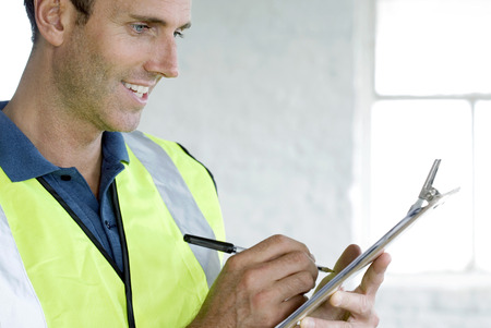 congeniality: A postal service supervisor compiling data Stock Photo