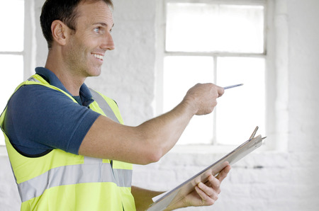 A postal service supervisor giving instructions
