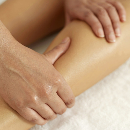 Woman enjoying a leg massage photo