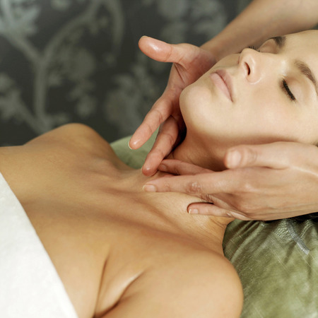 Woman enjoying a relaxing body massage photo