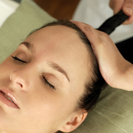 Woman enjoying a head massage photo