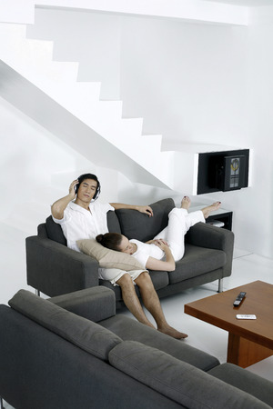 Couple resting in living room photo