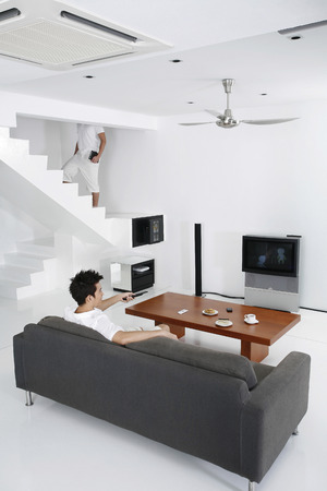 Man watching television in the living room photo