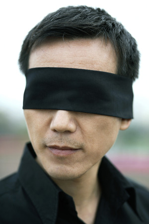 blindfolded: Businessman with his eyes being blindfolded