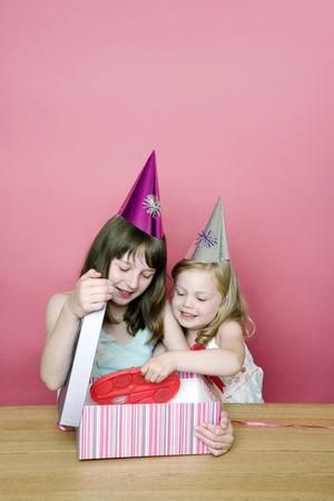Kids opening present photo