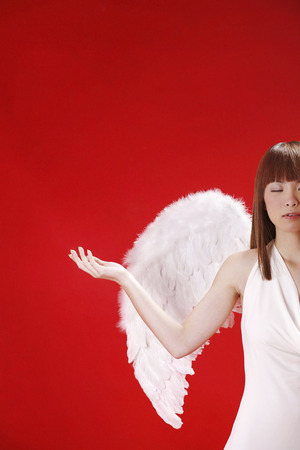 Young woman in angel costume