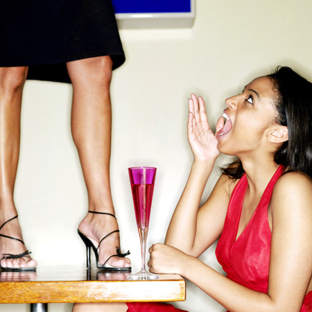 naughty woman: Naughty woman standing on top of table in a bar