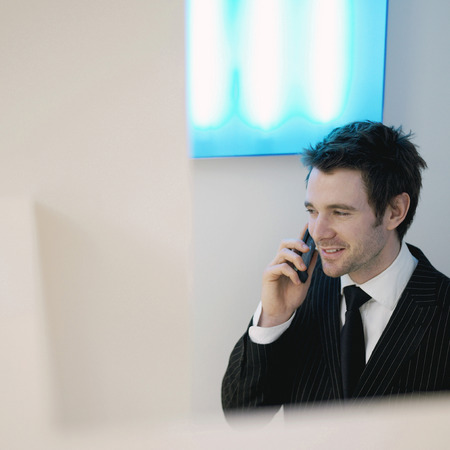 A guy in suit using cell phone photo
