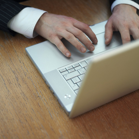 Executive using laptop photo