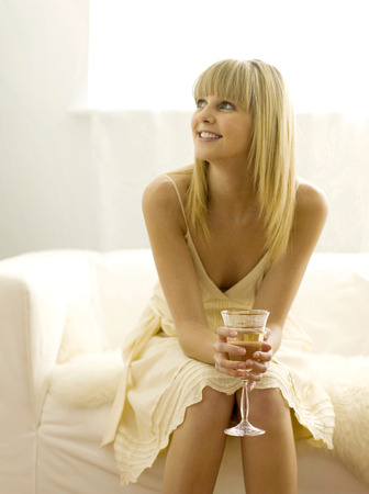 Pretty girl  holding a glass of wine photo