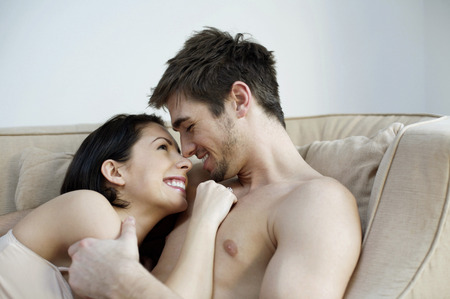Couple sharing intimate moment on the couch photo