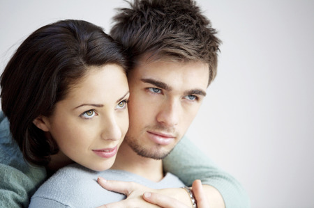 Woman hugging her boyfriend from behind Stock Photo - 26264625