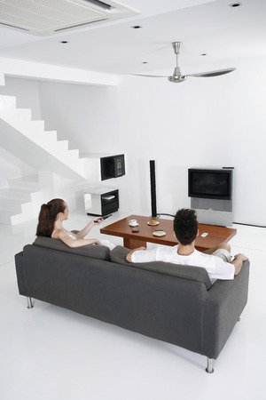 Couple watching television together