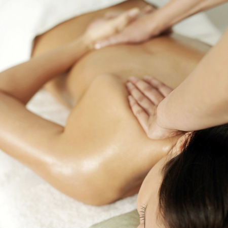 Woman enjoying a relaxing body massage Stock Photo - 26264993